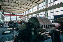 Large machines and equipment at an abandoned factory. In the city of Efremov, Russia Royalty Free Stock Photos