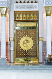 The large magestic doors of masjid nabawi, gold doors,  islamic architecture, islam. Royalty Free Stock Photo