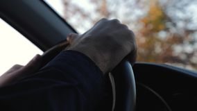 Large male hands on the steering wheel of the car. Driving a car. Journey.Business. stock video footage