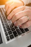 Male Hands Typing on Laptop Computer Keyboard. royalty free stock image