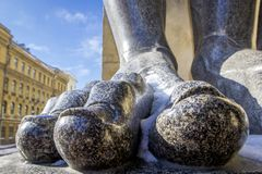 Fingers on the feet of Atlant`s statues that hold the ceiling of the New Hermitage, St. Petersburg, Russia. Large male toes of statues of Atlantes at entrance to royalty free stock images