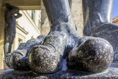 Fingers on the feet of Atlant`s statues that hold the ceiling of the New Hermitage, St. Petersburg, Russia. Large male toes of statues of Atlantes at entrance to stock images