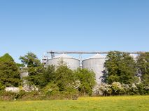 large malt factory industry building architecture behind field a stock photography