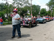 Large man marches in Fourth of July parade royalty free stock photography