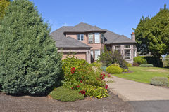 Large mansion and a full garden Oregon. Royalty Free Stock Photos