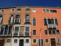 A large mansion lit by the sun in Venice in Italy Royalty Free Stock Image