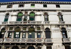 A large mansion with two large balconies and four small Venice in Italy Stock Image