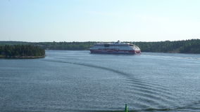 Large marine ferry sailing through the ducts Norstrom in the Baltic sea stock video