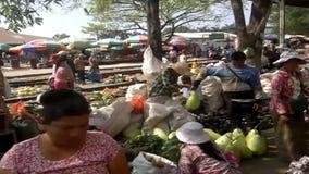 A large market on the station platform and along the rail track, Danyingon Railway Station, Yangon, Myanmar stock video