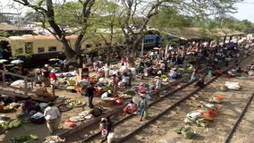 A large market on the station platform and along the rail track, Danyingon Railway Station, Yangon, Myanmar stock video footage