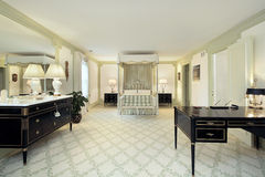 Large master bedroom. Traditional large master bedroom in luxury home royalty free stock photo