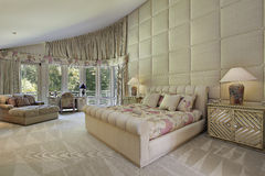 Large master bedroom with doors to balcony Royalty Free Stock Photography