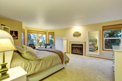 Large master bedroom with fireplace. Stock Photos