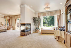 Large master bedroom in luxury home with doors to balcony. Royalty Free Stock Photos