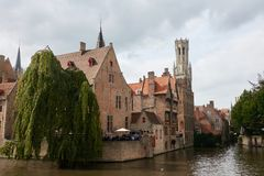 A large medieval house on the water in the tourist town of Bruges royalty free stock image