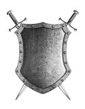 Large medieval shield with two crossed swords coat of arms. Large medieval shield with two crossed swords isolated on white Stock Images
