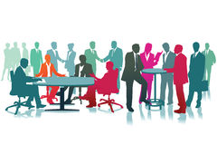 Large Meeting of Business People. Silhouettes of business people gathered in a large group for a meeting or a conference or convention Royalty Free Stock Photos