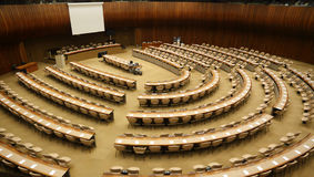 Large meeting chamber. Huge international meeting chamber with chairs and tables put up in concentric semicircles of United Nations in Geneva, Switzerland Stock Photography