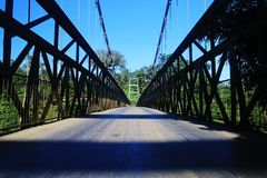 A large metal bridge with safety cables and a thick metal bars royalty free stock photography