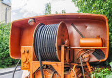 Large metal coil with electric cable on a special car Stock Photo