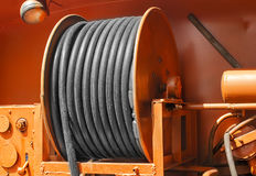 Large metal coil with electric cable on a special car Royalty Free Stock Photo
