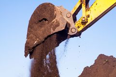 Bucket of an excavator against mountain and sky royalty free stock images