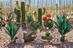 Buddha Garden Sculpture Display in Nevada Cactus Nursery stock photography