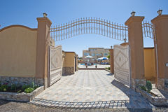Large metal gated entrance to luxury tropical villa Royalty Free Stock Image