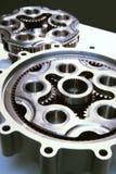 Large metal gears. A closeup of two large modern metal gears Stock Photos