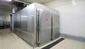 Large metal industrial fridge stock image
