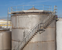 Large metal industrial tanks for petrol and oil of refinery indu Royalty Free Stock Photos