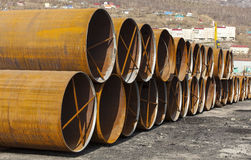 Large metal pipes on the ground Stock Images