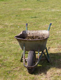 Large Metal Wheelbarrow filled with manure Stock Image