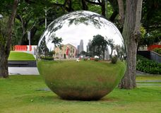 Large metallic mirror ball outside the Museum of Ancient Civilisations in Singapore. Large metallic sphere on display outside the Museum of Ancient Civilisations royalty free stock photos