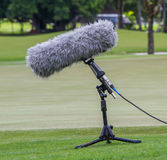 A large microphone boom with stand for TV or Radio situated. Royalty Free Stock Photo