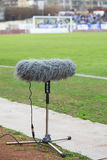 Large microphone boom for tv. At a football stadium Stock Image