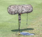 A large microphone boom with windshield situated at the ground. Royalty Free Stock Photo