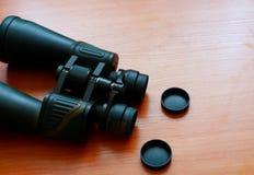 Binoculars on table stock photography