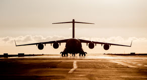 Large military cargo plane silhouette Royalty Free Stock Photos