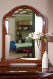 A large mirror in a wooden frame, royalty free stock photos