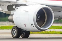 Large modern aircraft view of the huge engine and chassis, the light of the sun. Large modern aircraft view of the huge engine and chassis, the light of the sun Stock Image