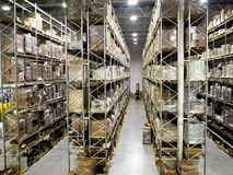 Large modern blurred warehouse industrial and logistics companies. Warehousing on the floor and called the high shelves stock images