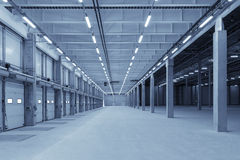 Large modern empty storehouse. With blue tint Stock Photo