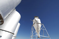 Large modern farm grain silos with blue sky Stock Images