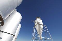 Large modern farm grain silos with blue sky Stock Images