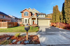 Large modern house with driveway, and garage. Stock Photography