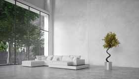 Large modern living room overlooking trees Royalty Free Stock Images
