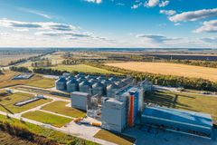 Free Large Modern Silos Granary Steel Tanks Or Containers For Silos, Wheat And Other Cereals. Industrial Agriculture, Aerial View Stock Images - 127546404