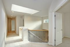 Second floor landing with skylight and staircase. Large Modern Skylight Illuminates the landing and staircase in this modern home Royalty Free Stock Image