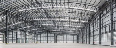 Large modern storehouse with some goods. And space area Royalty Free Stock Photography